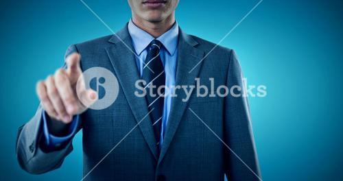Composite image of midsection of well dressed businessman pointing