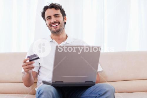 Smiling man buying online