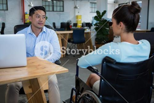 Businessman interacting with disabled colleague