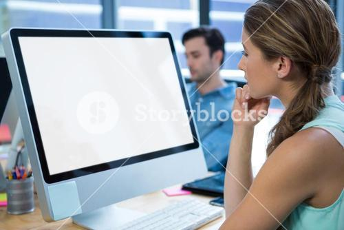 Beautiful woman working on desktop pc