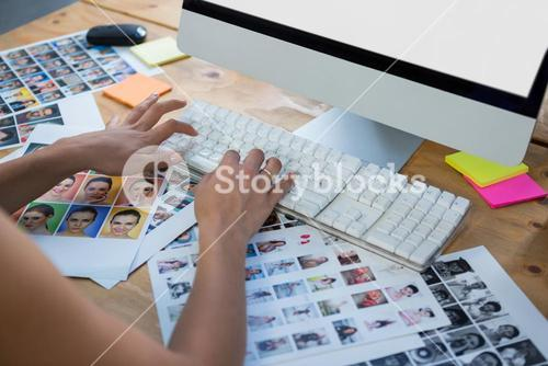 Woman working on desktop pc