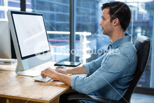 Man working on desktop pc