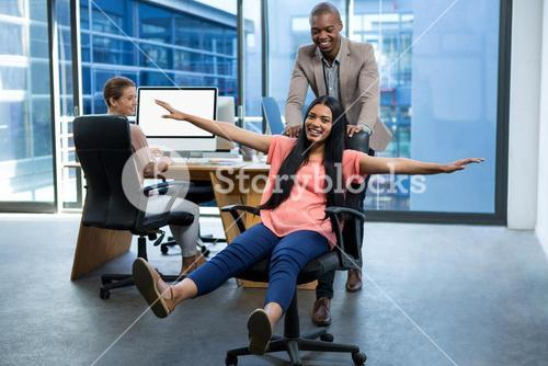 Business executives having fun in office