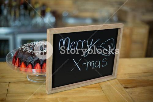 Merry x mas sign board with cake at counter