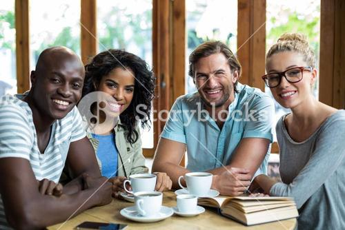 Portrait smiling friends in café