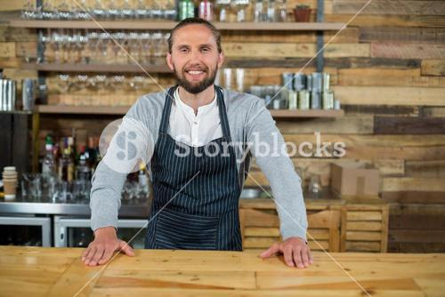 Portrait of waiter standing at counter