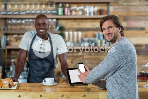 Man using mobile phone at counter