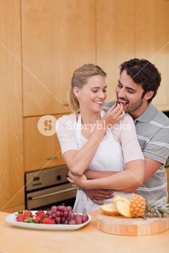 Portrait of a young couple eating fruits