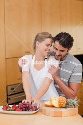 Portrait of a lovely couple eating fruits