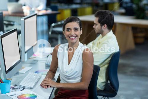 Portrait of female graphic designer working on personal computer