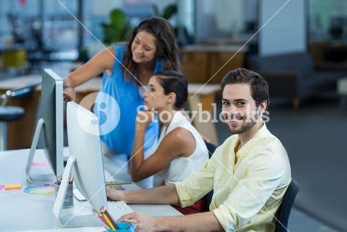 Portrait of male graphic designer working on personal computer
