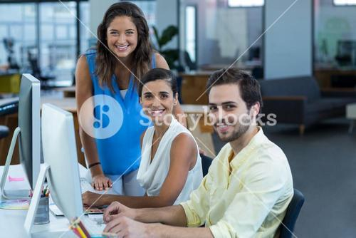 Portrait of graphic designers working on personal computer