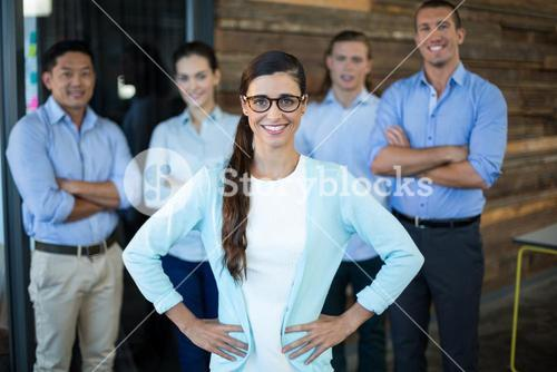 Portrait of businesswoman standing with hands on hip