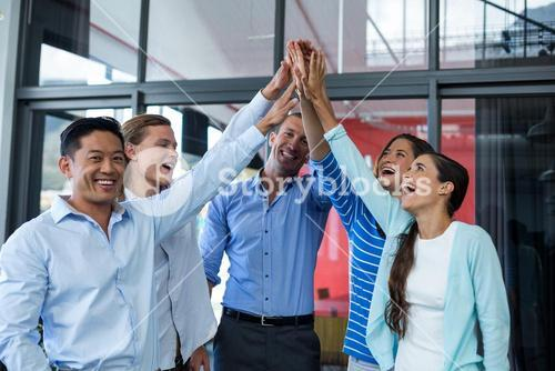 Team of businesspeople giving high five