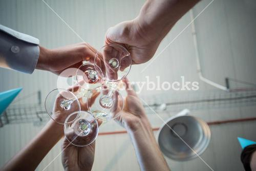 Businesspeople toasting a glasses of wine