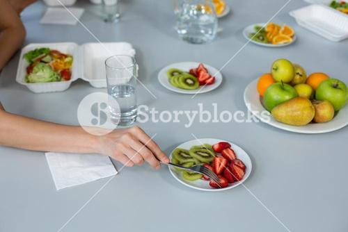 Business executive having meal on dining table