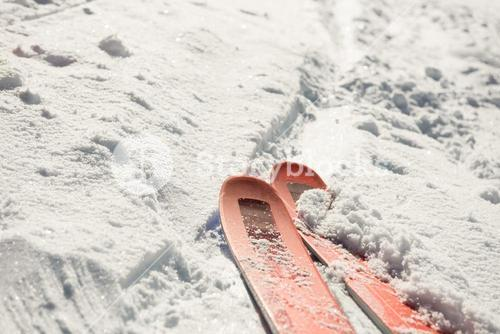 Close-up of ski on snowy landscape