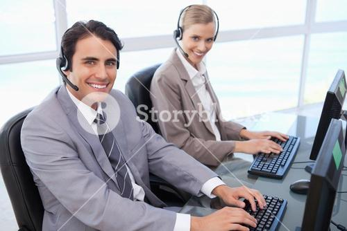 Happy operators working with a computer