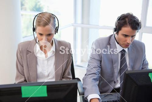 Focused operators working with a computer