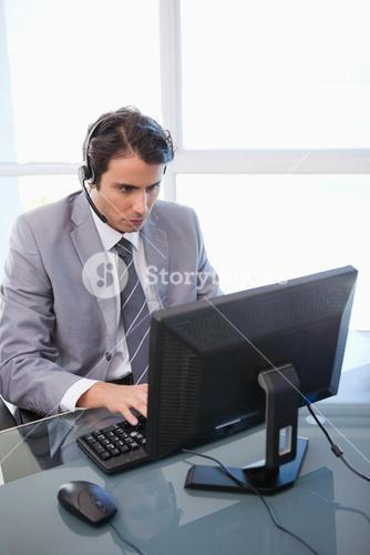 Portrait of a sales assistant working with a monitor