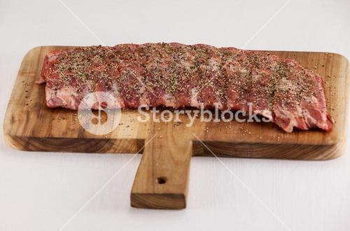 Spices sprinkled on beef ribs