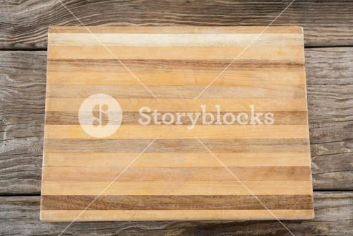 Wooden tray against wooden background