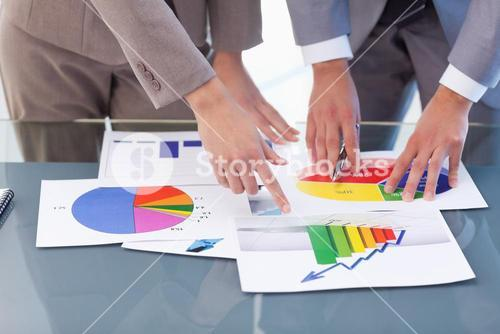 Hands of business people studying statistics
