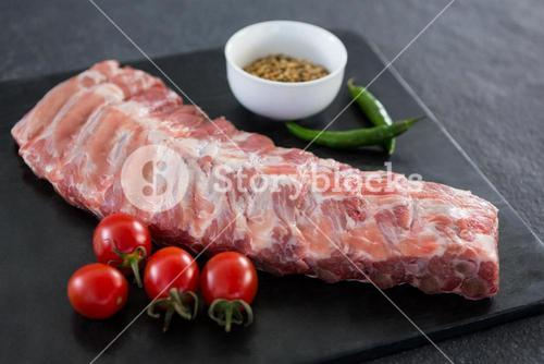 Beef ribs, cherry tomatoes and coriander seeds