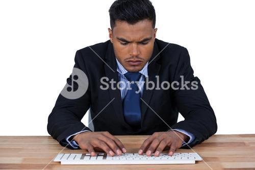 Businessman typing on keyboard at desk