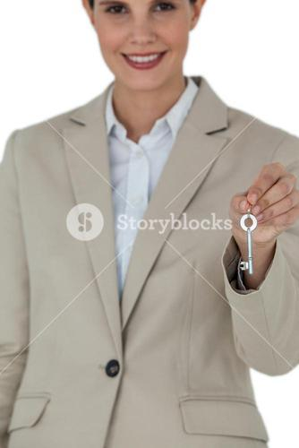 Businesswoman showing new house key