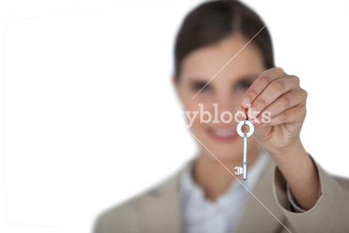 Close-up of businesswoman showing new house key