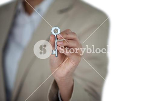 Mid section of businesswoman showing new house key