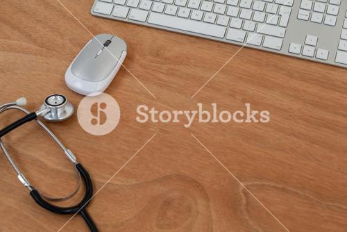 Stethoscope with keyboard and mouse on table