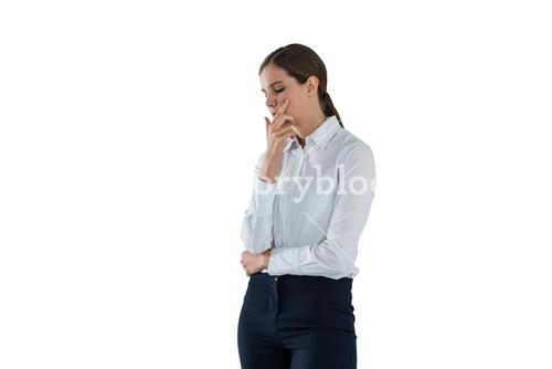Thoughtful businesswoman standing with hand on face