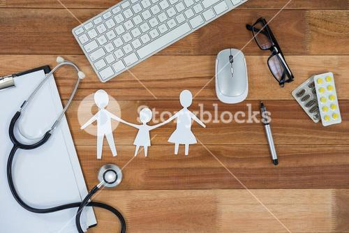Paper cut out family chain with medicine, mouse, keyboard, stethoscope, clipboard and spectacles
