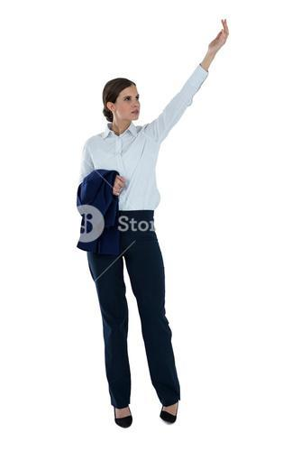 Businesswoman pretending to hold an invisible object