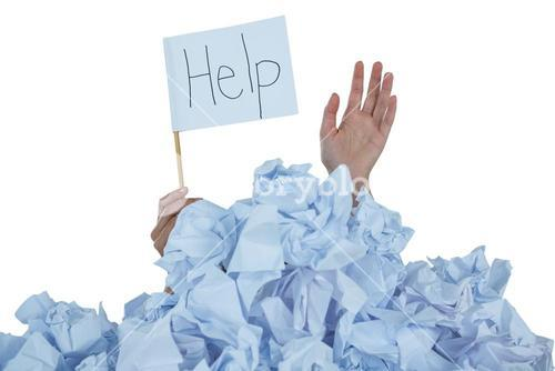 Conceptual image of woman in heap of crumple paper asking for help