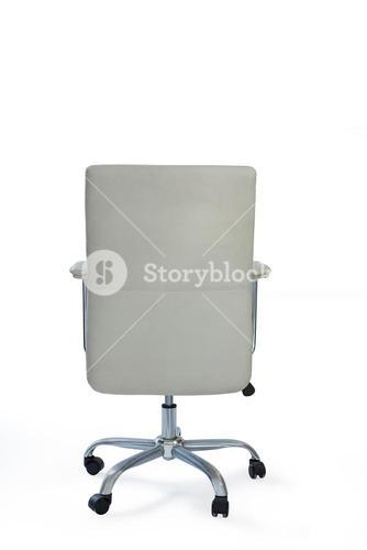 Wheeled office chair against white background