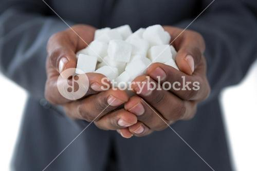 Mans hand cupped with sugar cubes
