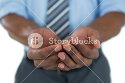 Businessman with hands cupped
