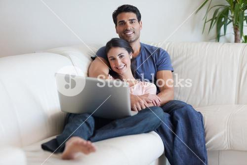 Couple watching a movie with a laptop