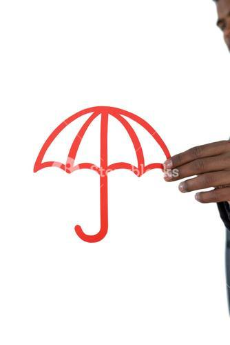 Close-up of businessman holding cut out umbrella