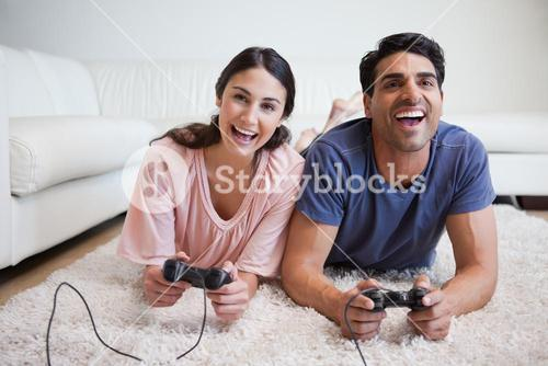 Playful couple playing video games