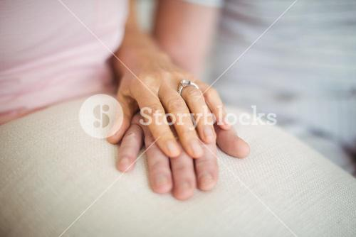 Senior couple holding each others hands