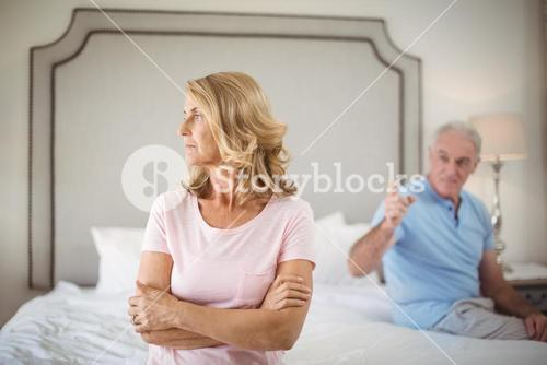 Couple having an argument in bedroom