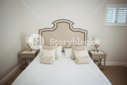 Empty bed in bedroom