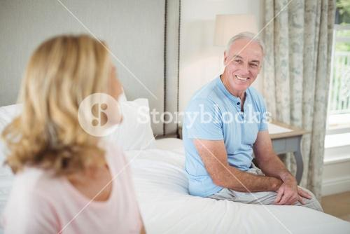 Senior couple interacting with each other in bedroom