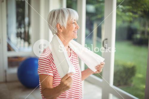 Senior woman with towel at home
