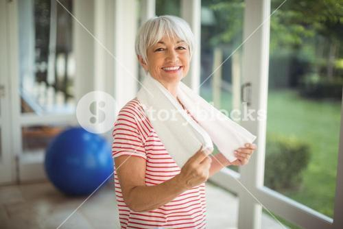 Portrait of senior woman with towel at home