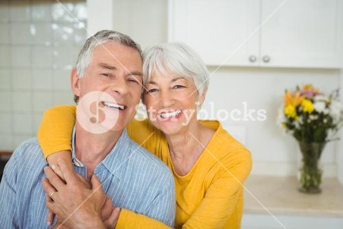 Happy senior couple in kitchen